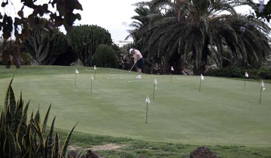 Tourist playing golf in the Golf Course of Costa Teguise, Lanzarote