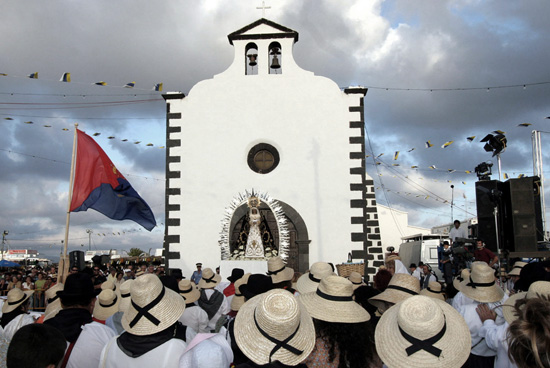 "Procession of <em>Los Dolores</em>, Lanzarote"" border=""0″ class=""centro"" /></p><p>The other important island celebration is the carnival, typically celebrated during February, although the exact date depends on Holy Week, and as such, on the lunar calendar. The Arrecife carnival, originally a seafarers tradition, is the main ""mask party"" in Lanzarote, and in addition to the countless night time outdoor festivities, important events include contests for the Carnival Queen and Drag Queen, as well as musical performances and parades. <a href="