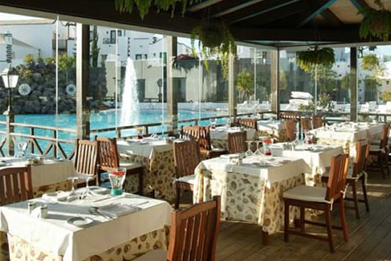 Spectacular terrace-restaurant of Meliá Volcán, 5-star hotel in Playa Blanca